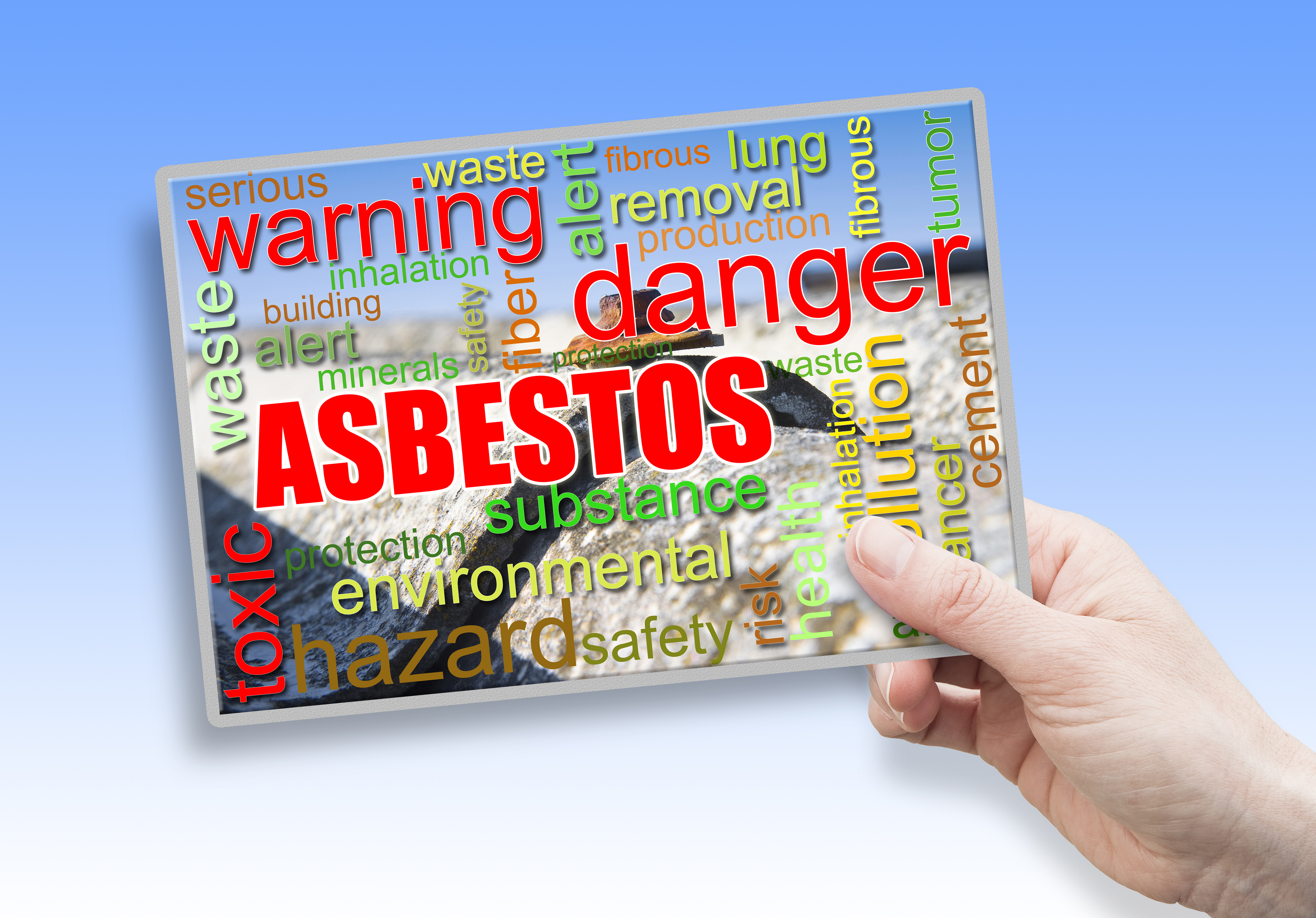 Female hand holding an card with asbestos theme